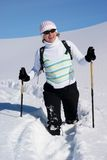 Smiling woman on a snow path Royalty Free Stock Photos