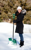 Smiling Woman with SNow Shovel. An attractive smiling woman holding a snow shovel Stock Images