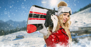 Smiling woman with snowboard. Smiling winter woman with snowboard stock images