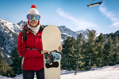 Smiling woman in snowy mountains, extreme sport and winter holid Stock Photos