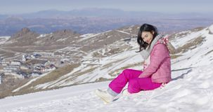 Smiling woman on snowy slope stock video footage