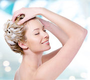 Smiling woman soaping her hair Stock Images