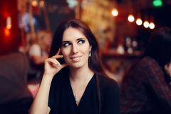Smiling Woman at a Social Party in a Pub Royalty Free Stock Photos