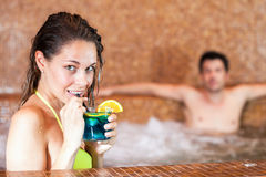 Smiling woman in a spa Stock Photos