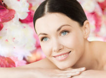 Smiling woman in spa lying on the massage desk Royalty Free Stock Photography