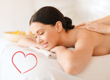 Smiling woman in spa salon getting massage Royalty Free Stock Photography