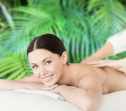 Smiling woman in spa salon getting massage Stock Photo