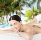 Smiling woman in spa salon getting massage Stock Photo