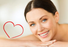 Smiling woman in spa salon Stock Photography