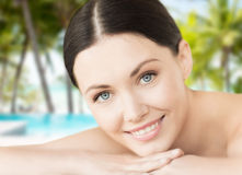 Smiling woman in spa salon. Spa, resort and vacation concept - smiling woman in spa salon lying on the massage desk stock images