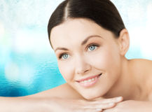 Smiling woman in spa salon Royalty Free Stock Image