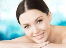 Smiling woman in spa salon Stock Photos