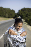 Smiling Woman in Space Blanket Royalty Free Stock Image