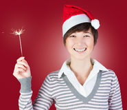 Smiling woman with sparkler Stock Photos