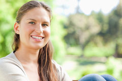 Smiling woman spending her day in the park Stock Photos