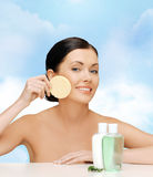 Smiling woman with sponge Stock Photo
