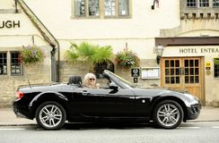 Smiling woman in sports car stock photo