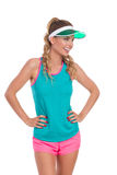 Smiling Woman In Sports Clothes And Sun Visor Looking Away Royalty Free Stock Photography