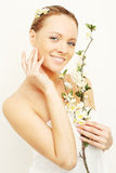 Smiling woman with spring apple flowers Royalty Free Stock Photography