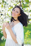 Smiling woman in spring blossoming garden Royalty Free Stock Images
