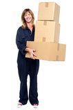 Smiling woman with stack of cardboard boxes Royalty Free Stock Photography