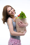 Smiling woman standign with shopping bag Royalty Free Stock Photography