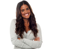 Smiling woman standing with arms crossed stock photos