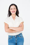 Smiling woman standing arms crossed Stock Photography