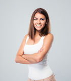 Smiling woman standing with arms folded Royalty Free Stock Image
