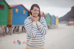 Smiling woman standing at beach Stock Photos