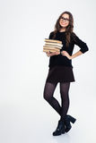 Smiling woman standing with books Stock Photo