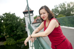 Smiling woman standing on bridge Stock Photography