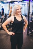 Smiling woman standing in a gym Stock Image