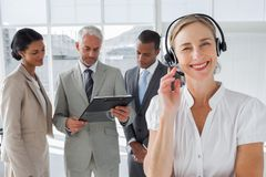 Smiling woman standing with a headset Stock Images