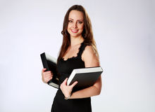 Smiling woman standing and holding books Royalty Free Stock Photos