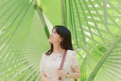 Smiling Woman Standing Near Green Leaf Plants Stock Images