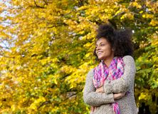 Smiling woman standing outdoors with arms crossed Stock Photos