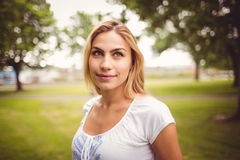 Smiling woman standing in park Royalty Free Stock Images