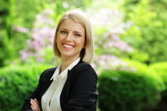Smiling woman standing in park Stock Photography