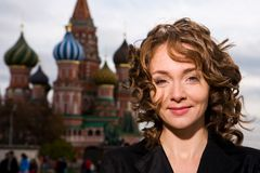 Smiling woman standing on the Red Square in Moscow Stock Images
