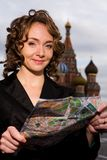 Smiling woman standing on the Red Square in Moscow Royalty Free Stock Image