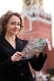 Smiling woman standing on the Red Square in Moscow Royalty Free Stock Images