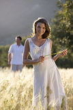 Smiling woman standing in rural field. Smiling women standing in rural field stock image