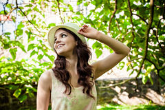 Smiling woman in straw hat staying in the park Royalty Free Stock Image