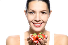 Smiling Woman with Strawberries in her Hand Stock Photo