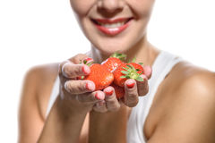 Smiling Woman with Strawberries in her Hand. On white background Royalty Free Stock Photos