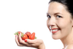 Smiling Woman with Strawberries in her Hand Royalty Free Stock Photo