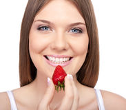 Smiling woman with strawberry Stock Photo