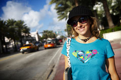 Smiling woman in street Stock Photo