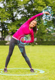 Smiling woman stretching back outdoors Royalty Free Stock Image